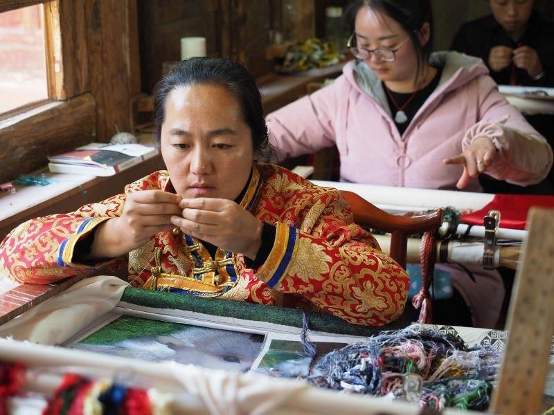 Local women weaving, Jinghong