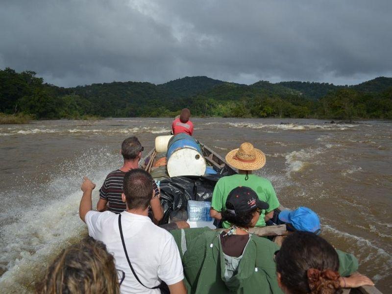 Tourists on speedboat on Guyana river