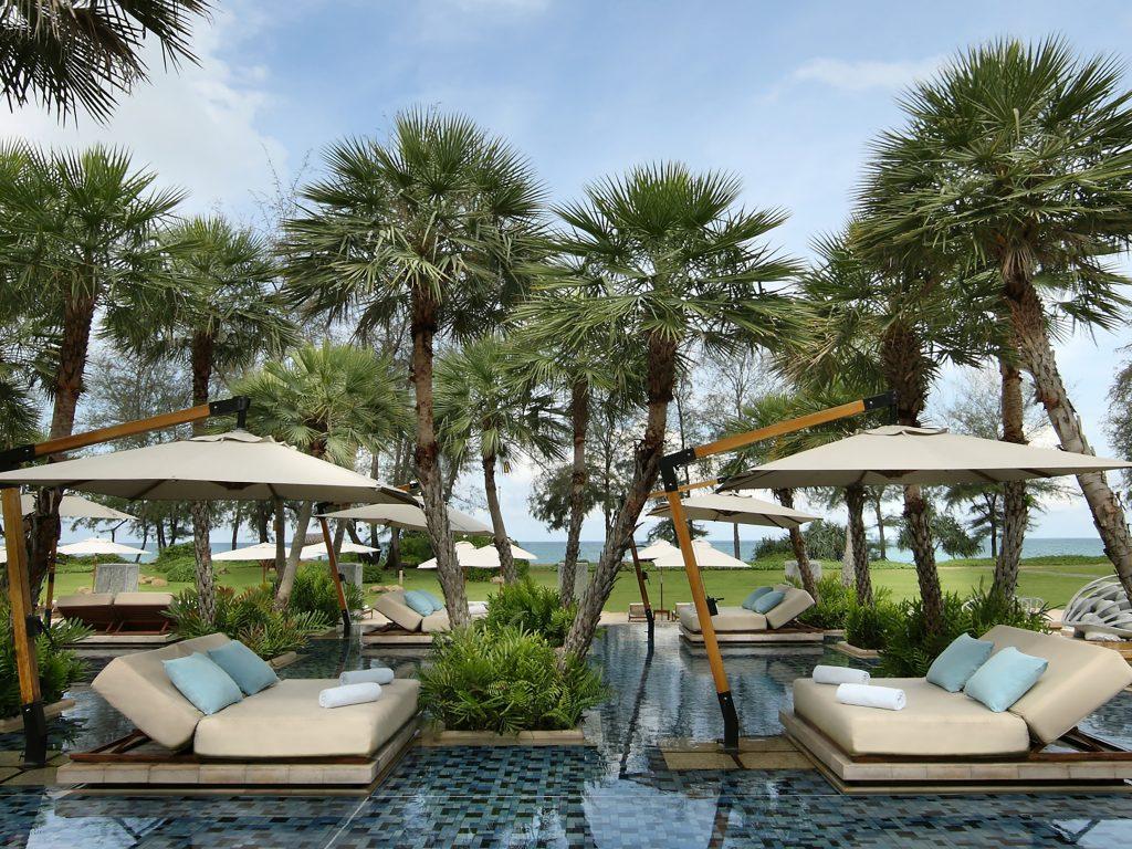 Relax by the pool at Anantara Mai Khao Phuket Villas