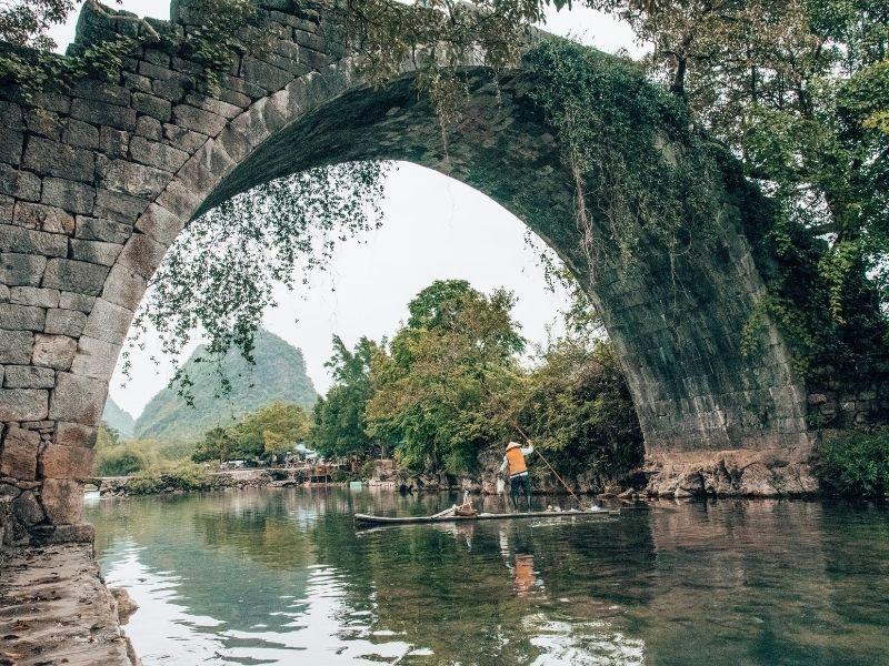 Man on bamboo raft, Yulong river