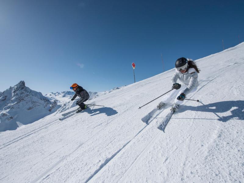 Two skiiers Courchevel Three Valleys